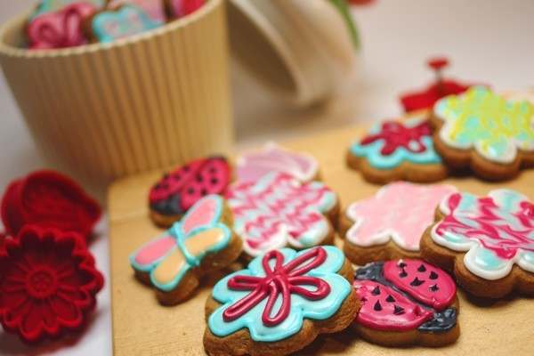 Several colourful flower biscuits
